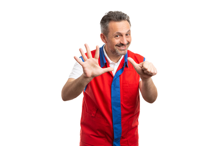 Joyful supermarket or hypermarket male employee holding up six fingers as counting sixth gesture isolated on white studio background Banco de Imagens