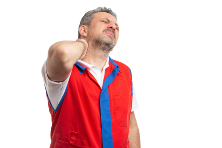 Supermarket or hypermarket employee in pain holding back of neck as stretched muscle isolated on white background Фото со стока