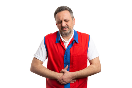 Nauseous hypermarket or supermarket male employee touching hurting belly with hands as stomachache concept isolated on white Stockfoto - 120444492
