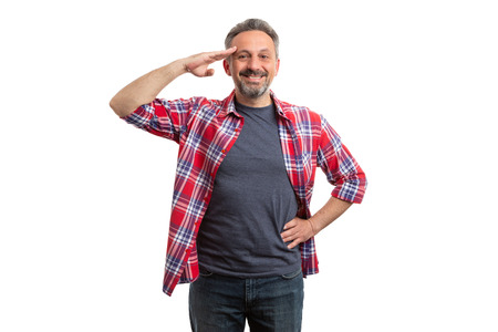 Smiling man touching forehead with hand as military salute concept isolated on white studio background Archivio Fotografico
