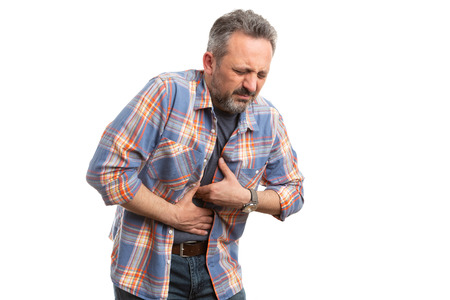 Man having gastric health problems touching stomach with nauseous expression wearing casual clothes isolated on white