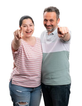 Friendly man and woman pointing at camera with index fingers as look concept isolated on white background Stock Photo