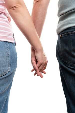 Man and woman holding hands as couple concept isolated on white studio background closeup Stock Photo