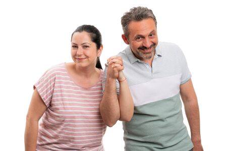 Man and woman couple holding hands as cute gesture isolated on white studio background
