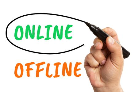 Man choosing online option green text on transparent screen as circling with black marker isolated on white background