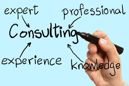 Man making consulting scheme with arrows as brainstorming concept using black marker on blue background Stock Photo