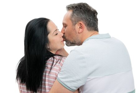 Closeup of man and woman couple kissing as romantic couple concept isolated on white studio background Stock Photo