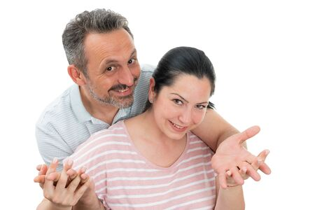 Portrait of man and woman couple hugging with fingers crossed isolated on white background