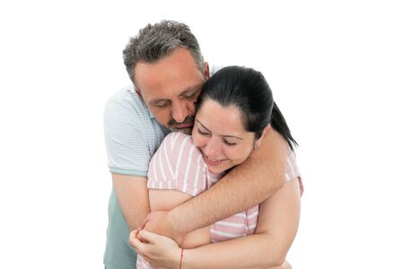 Closeup of man and woman couple hugging as cute relationship concept isolated on white studio background Stock Photo