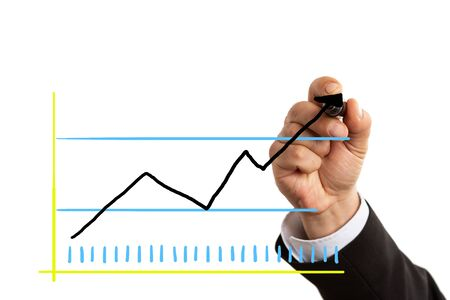 Businessman wearing suit drawing arrow on graph as economic growth concept isolated on white background