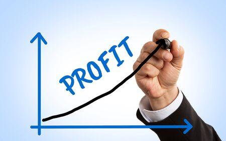 Closeup of man wearing suit making profit arrow on graph as growth concept with blue background Stock Photo