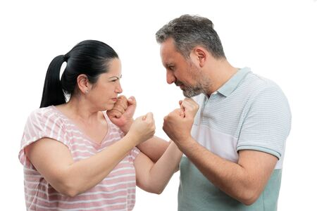 Man and woman holding fists up while shouting as couple argument concept isolated on white background