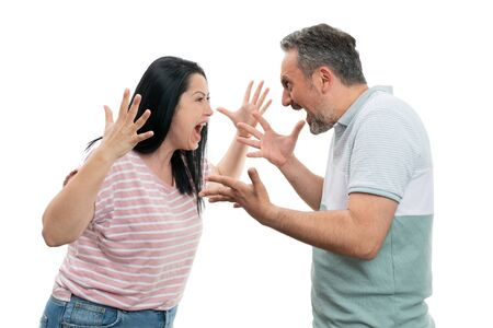 Angry man and woman fighting making gestures with palms as couple concept isolated on white studio background Stock Photo
