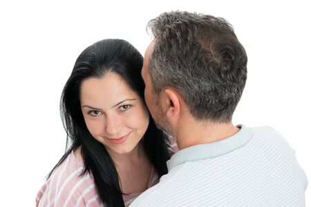 Loving couple hugging with smiling woman looking at camera isolated on white background