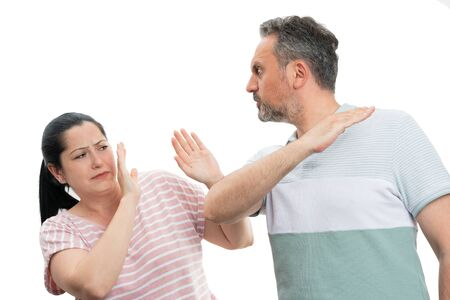 Angry man threatening scared woman with palms as domestic violence concept isolated on white