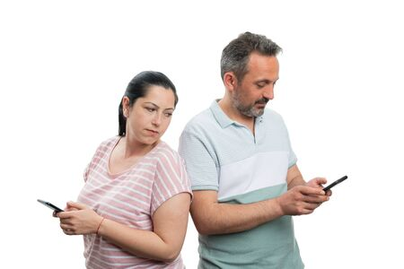 Woman with curious expression looking over shoulder at male boyfriend phone while texting isolated on white