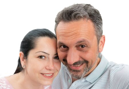 Man and woman couple smiling as taking selfie isolated on white studio background