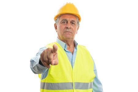 Closeup of elder builder man touching invisible display with index finger isolated on white studio background 写真素材
