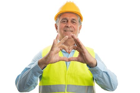 Old male builder with serious expression holding up four fingers as counting concept isolated on white background Фото со стока