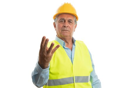 Male builder with friendly expression holding fingers up as number three isolated on white 写真素材