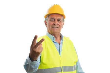 Serious builder man making stop gesture with palm and angry expression isolated on white studio background 写真素材