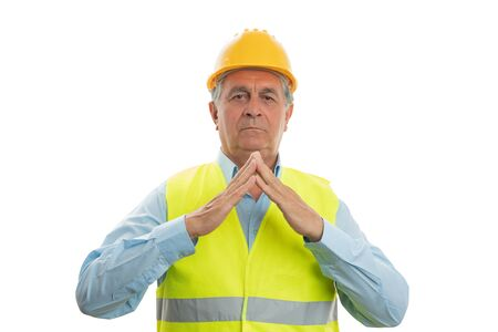 Old male construction worker making rooftop gesture with hands as protection concept isolated on white
