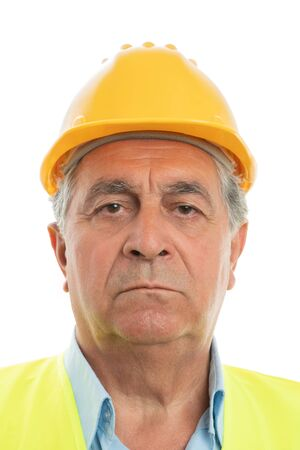 Closeup portrait of old male builder wearing yellow hardhat and fluorescent vest isolated on white background 写真素材
