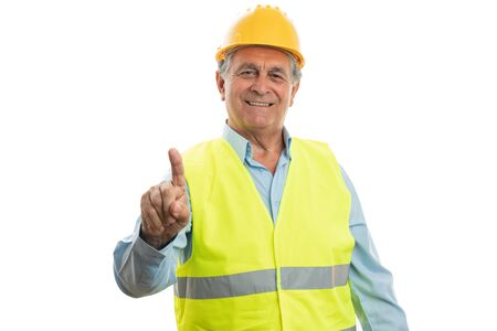 Old male builder touching invisible screen as blank copyspace with index finger isolated on white background 写真素材
