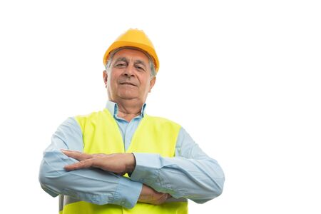 Old builder man portrait from below with arms crossed isolated on white background Stock Photo