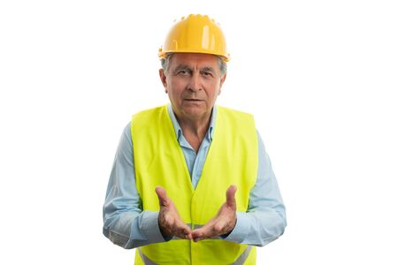 Old builder with confused expression and gesture asking question isolated on white studio background