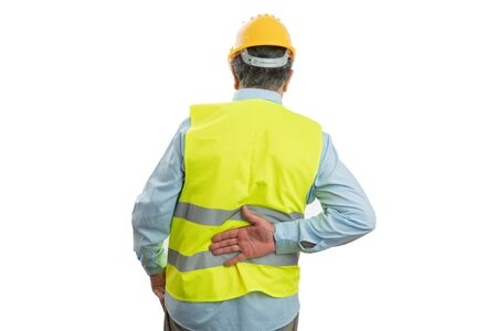 Old male builder holding hand on painful back as physical effort concept isolated on white background