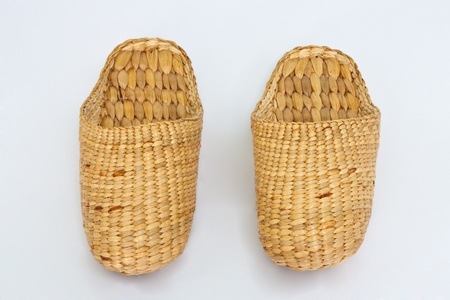 handmade slippers from dry water hyacinth on white background  photo