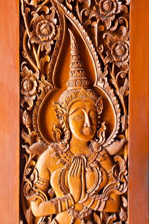 Thai style wood carving on door temple  photo