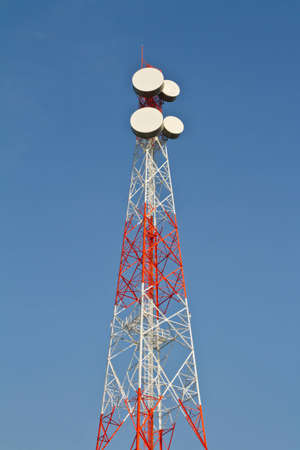 Communications tower with blue sky photo