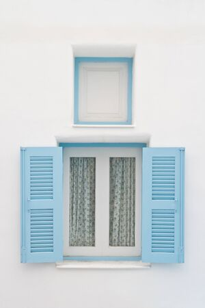 Blue window on white house photo