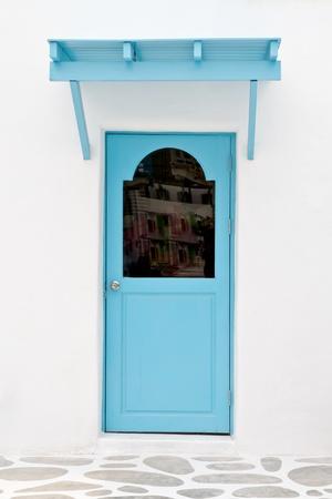 Blue door with sunshade