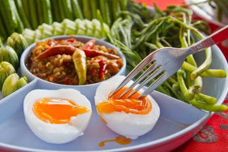 Tamarind paste chilli sauce with egg and vegetable photo