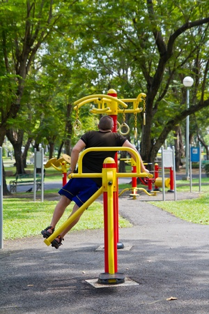 reciprocate: A man workout in the public park Stock Photo