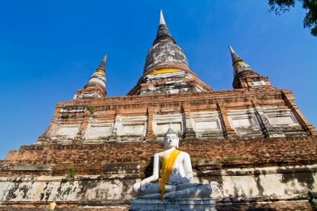 Ancient pagoda and buddha statue in Wat Yai Chaimongkhon, Ayutthaya province,Thailand photo