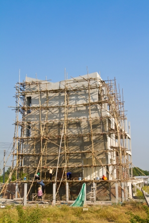 Building under construction and bamboo scaffolding photo