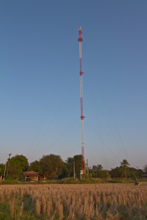 Communication tower in rural of thailand photo