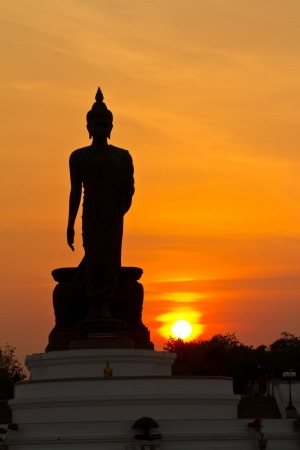 Silhouette of buddha statue photo