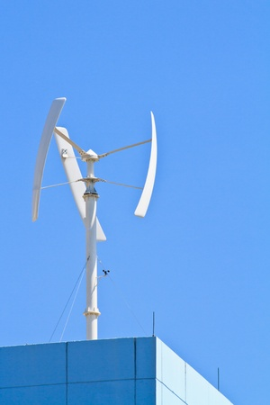Vertical wind turbine on the top of building photo