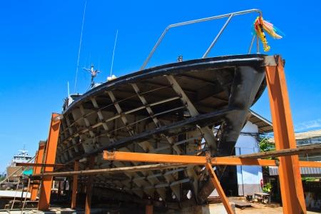 Military boat on repair in dry dock  photo