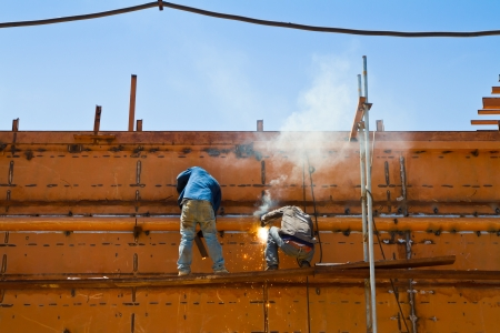Worker building ship