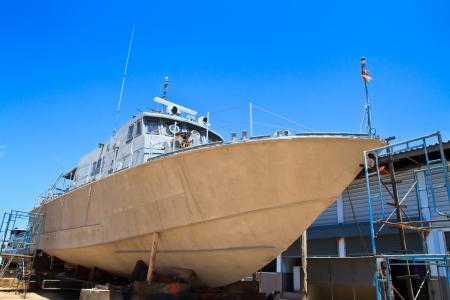 Military boat on repair in dry dock