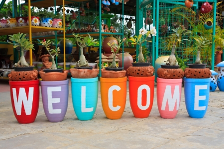 Colorful welcome pots Stock Photo
