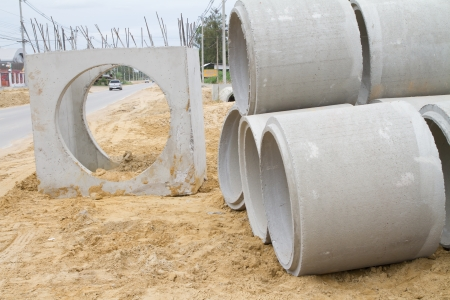 Concrete drainage tube on construction site  photo