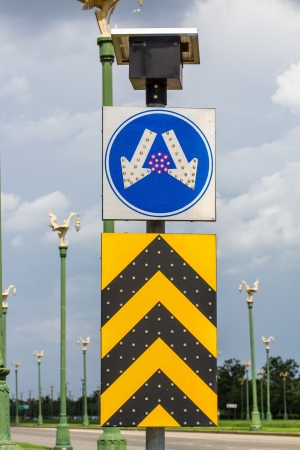 Road split sign with led light and solar cell on top photo