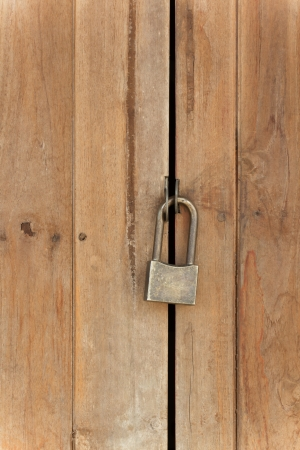 Padlock on old wooden wall Stock Photo - 22722533